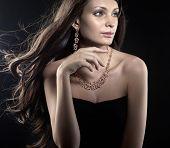 Beautiful woman wearing gold jewellery