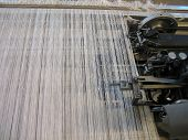 pic of handloom  - Strings in a weaving handloom - All strings attached - Textile abstract