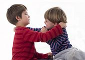 stock photo of crew cut  - two brothers fighting - JPG