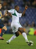 BARCELONA - JAN, 2: Nigerian player Sunday Mba in action during the friendly match between Catalonia