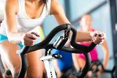 stock photo of exercise bike  - Young People  - JPG