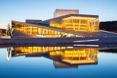 OSLO, NORWAY - JANUARY 1: National Oslo Opera House shines at sunrise on January 1, 2013. Oslo Opera House was opened on April 12, 2008 in Oslo, Norway