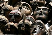 stock photo of woodcarving  - African masks for sale at an open - JPG