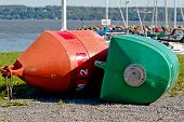 Green And Orange Buoy In Front Of Harbor