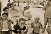 Young children play on a street of Khayelitsha
