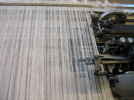 pic of handloom  - Strings in a weaving handloom - All strings attached - Textile abstract ** Note: Shallow depth of field - JPG