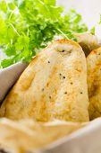 Naan Breads In Basket With Cilantro