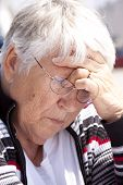 stock photo of nana  - Stressed out grandmother  - JPG