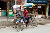 Traveller taking a local bicycle rickshaw,Kathmandu,Nepal