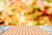 foto of fantastic  - Empty wooden table and autumn bokeh background - JPG