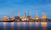 picture of carbon-dioxide  - Oil refinery plant near river in twilight - JPG
