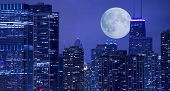 stock photo of illinois  - Skyline and Large Moon on the Horizon - JPG