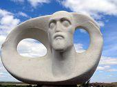 Sculpture Of A Man In Historic Landscape Museum-reservation Arkaim poster