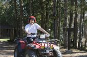 Young Man Riding A Quad