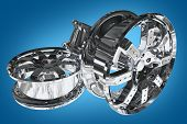 picture of alloys  - Chromed Car Alloy Wheels on Blue Background - JPG