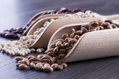 stock photo of pinto bean  - Close up photo of a beans in wooden scoop  - JPG