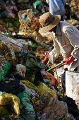 People pick up rubbish at landfill