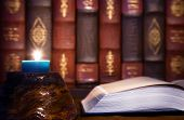 Antiquity - Reading Old Books With Candle Light
