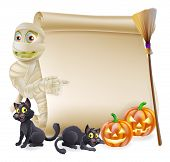 stock photo of mummy  - Halloween scroll or banner sign with orange carved Halloween pumpkins and black witch - JPG