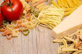 Different Italian Pasta, Pecorino And Red Tomato