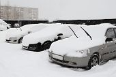 Cars Under Snow On Parking Place
