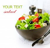 Salad. Greek Salad isolated on a White Background. Mediterranean Salad with Feta Cheese, Tomatoes an