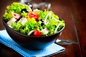 Greek Salad Bowl. Mediterranean Salad with Feta Cheese, Tomatoes and Olives. Healthy fresh vegetaria