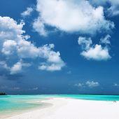 Beautiful island beach with sandspit at Maldives