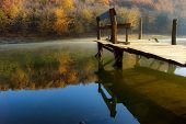 Peer pontoon on a beautiful lake in autumn