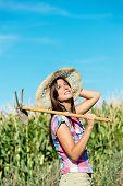 Successful Female Farmer In Corn Field