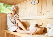 picture of sauna woman  - Young attractive woman smiling and relaxing in sauna at spa - JPG
