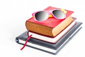 Woman's Sunglasses On The Books