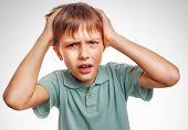 Boy child man upset angry shout produces evil face portrait isol