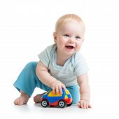 stock photo of crawling  - smiling kid boy playing with car toy - JPG