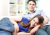 Attractive Woman Lengthened On The Thighs Of Her Boyfriend