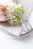 image of buttercup  - Festive wedding elegant dining table setting with a bouquet of flowers buttercups and white lilac and vintage cutlery on a white table - JPG