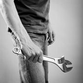 Man Holding Wrench Black And White