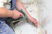 Manual Worker Disassembling Old Floor Tiles