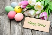 image of gratitude  - Easter eggs and tulips with a tag on wooden background - JPG