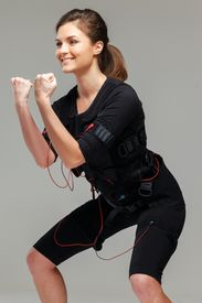 picture of stimulating  - Young woman doing exercise  in Electro Muscular Stimulation EMS training costume  - JPG