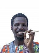 African man holding a miswak (teeth cleaning twig), isolated