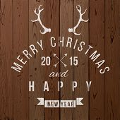 Christmas type design over wooden background