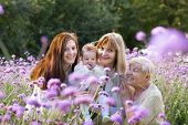 Four Generations Of Beautiful Women Standing In A Colorful Lavender Field