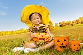 Halloween girl in costume of a bee sitting