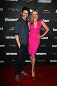 LOS ANGELES - AUG 23:  James Frain, Mira Sorvino at the 2014 Entertainment Weekly Pre-Emmy Party at
