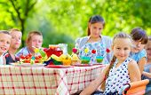Happy Kids Around Picnic Table