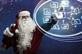 Santa Claus touching icon of media screen