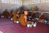 Buddhist Monk Is Waiting For Breakfast Given By People Who Want To Make Great Merit