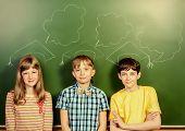 Schoolchildren stand at the blackboard in the classroom. Educational concept. New idea.