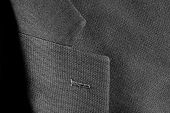 Detail closeup close-up of suit jacket lapel button hole fabric